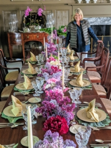 Here I am next to a most gorgeous spring dining table - filled with all sorts of flowers from my gardens - lilacs, tree peonies, Solomon's Seal, Dicentra, azaleas, daffodils, and more.