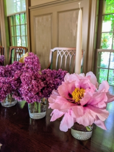 And for the centerpiece, smaller glasses are used to hold peonies and lilacs mixed with various other flowers from the gardens.