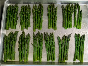 Inside my kitchen, Chef Pierre prepares the asparagus for cooking. There is so much wonderful asparagus growing in my garden right now - we harvested bucket-fulls for my two gatherings.