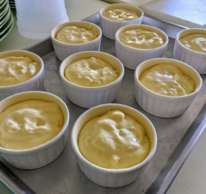 """A soufflé is a baked egg-based dish which originated in early 18th century France. It is served as a savory main dish or sweetened as a dessert. When making any souffle, timing is crucial. """"Souffles don't wait for guests; guests must wait for the souffle."""" Chef Pierre pours the mixture into these dishes and then they're baked in a pre-heated 400-degree Fahrenheit oven until they are puffed and golden brown on top - about 15 minutes."""