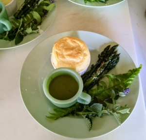 Here is a plate on its way to the dining room - one souffle and a cup of flavorful asparagus soup served with fresh asparagus. It was a delicious and healthy meal, which made for a very informative and successful meeting.