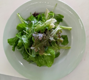 Each salad is dressed with a homemade balsamic vinaigrette. The salads are served just before the souffles.