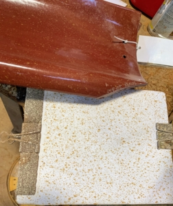 """The custom color is a """"two-spray"""" application. The tile is entirely sprayed with a gloss burgundy color and then lightly spotted with a gloss gold. (Photo courtesy of Ludowici)"""