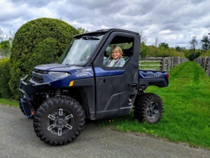 Here I am in my newest Polaris Ranger XP 1000. It is among the newest models available with 82 horsepower – one of the most powerful in its class. We use these Polaris vehicles every day for so many tasks.