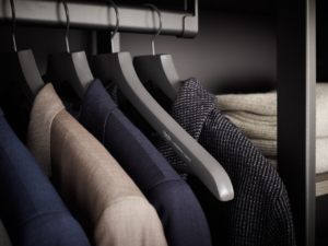 Durable hanging rods allow for several heavy suits. And premium hangers organize all the sports coats while protecting their shape and quality. (Photo by Douglas Friedman)