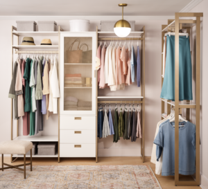 """This closet is the """"Perry St. White Woodgrain with Gold Metal"""" finishes modular set. This sophisticated system doubles the storage without compromising style. There's more than 11-feet of hanging space for all those dresses, blouses, and work outfits. (Photo by Douglas Friedman)"""