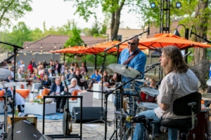 The band includes lead guitarist Bill Bonacci, rhythm guitarist Steve Liesman, Clare Maloney on vocals, and Ken Aigen on keyboard. (Photo by Gabe Palacio for Caramoor)