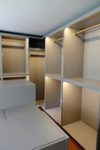 The closet spaces and dressers were custom designed for my wardrobe needs, and ample lighting was incorporated into every hanging space and cubby.