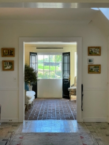 This is a view into the brick hallway in the Mellon's residence and the front door.