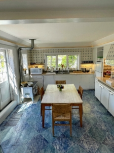 This is the Blue Kitchen, or Sunday Kitchen, at Oak Spring. Portuguese tiles, featuring Bunny's signature blue diamond patterned floor, are beautifully maintained. The windows offer great views of the garden.