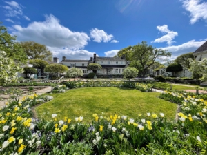 Many of Bunny's garden designs at Oak Spring remain intact. Tulips and Narcissus line the beds surrounding the square garden. This view looks south toward the Mellon's residence.