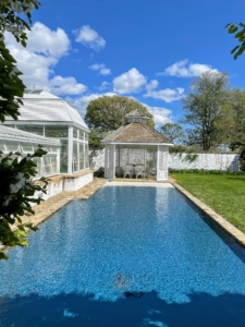 This is a reflecting pool in front of the Formal Greenhouse. Sitting at the end of the pool is the Cake House - a gazebo so named because it was used to shade the wedding cake when Bunny Mellon's daughter, Eliza Lloyd, married Derry Moore, the 12th Earl of Drogheda in 1968.