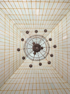 Looking directly up at the vaulted ceiling in the central room of the Formal Greenhouse is this decorative chandelier.