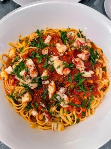 They were served with a bowl of pasta bolognese topped with lobster and parsley.