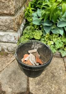 This container is filled with clay shards to use at the bottom of the pots for drainage. Before we start planting, we make sure all the supplies are ready – the urns, pots and planters, the tools, the potting mix, and of course the plants.