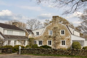 Paul and Bunny Mellon maintained residences in Europe, North America and the Caribbean, but their primary home was this estate in Upperville, Virginia called Oak Spring Farm. This is the front facade of the home. An Asian pear tree is espaliered against the front wall. (Photo by Max Smith, Oak Spring Garden Foundation)