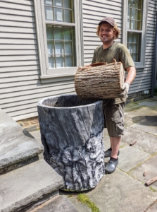A few of the faux bois pots are tall, so a two-foot section of a tree trunk is placed inside to keep the plant at an appropriate height. Ryan also places pieces of wood between the stump and the bottom of the pot as well as between the pot and the stump for good drainage.