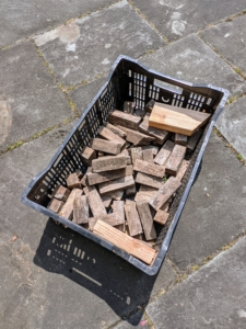 We always save small pieces of wood from year to year. These are used as shims under the pots, so the water drains fully.