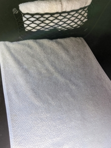 Andres also places a towel on the floor of both the driver's side and the front passenger side seats - with the ends tucked under the car's floor mats. Towels keep the area clean and are easy to pick up and throw in the wash at the end of the day.