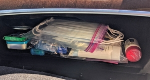 Everything is placed into the glove compartment along with a supply of fresh paper face masks.