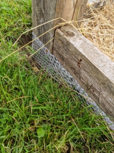Sturdy wire is placed several inches down in the ground around the entire perimeter to keep burrowing vermin away from the structure.