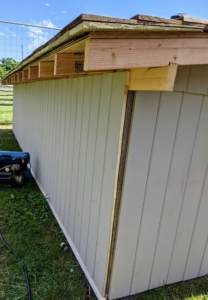 """Here is the back of the coop - the walls are secure and painted my signature """"Bedford Gray."""""""