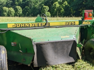 I am fortunate to have all the necessary equipment here at the farm. This is our mower-conditioner. A hay conditioner crimps and crushes the hay after it is cut to promote faster and more even drying.
