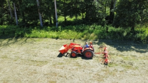 From above, one can see how the tedder works to turn the hay around and around.