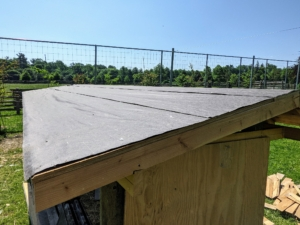 Next, the two create the roof using good quality plywood boards on top of the frame. Then, the roof is covered with roofing felt underlayment – a layer of protection installed between the roof deck and the roofing shingles. It provides shingle ventilation as well as a backup waterproof membrane in case of leakage.