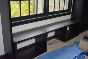 A long window seat with underneath storage was also built to maximize every inch of space.