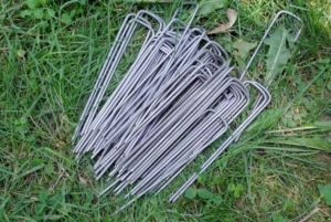 These sod staples are used to keep the netting taut and well-secured, but still easy enough to remove for harvesting. They are placed every few inches to ensure there are no openings for curious ground critters.