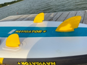 """In paddle boarding, surfing, windsurfing, and kitesurfing, skegs, usually known as """"fins"""", are attached toward the tail of the board to improve directional stability and control throughout the ride."""