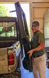 Here's Doug removing the door from its hinges - just lift and pull. These vehicles are built for easy maintenance.