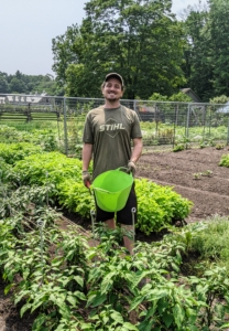 Here's Ryan just before harvesting this week's bounty. One can harvest any time of day, but when possible, the best picking time is early morning, when the sun is just clearing the eastern horizon and greens are still cool and dew-covered from the previous night.
