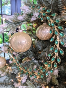 The wreath is also available in green rhinestone, and clear crystal - all with a gold base. We hung several on our tree, but they can be used on the wall or on your holiday dinner table.