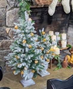 We placed these Flocked Globe Light Tabletop Urn Trees on the hearth - one can never have too many trees. They look so natural and festive.