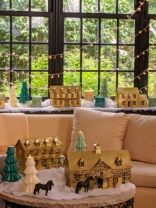 In this living room, we decorated the windowsill and coffee table with my flameless candles and Illuminated Metal Houses - they look so great.