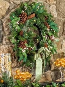 This lush wreath decorated with faux foliage will look wonderful above the fireplace, hung on a door, or used as a centerpiece. It is pre-lit with lifelike tree tips, faux white berries, eucalyptus, cedar leaves, and pinecones. 50 warm white LED lights make it even more special, and it can be used indoors and out.