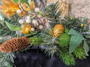 Here is the gold strand wrapped around my Pre-Lit Eucalyptus, Pinecone and Berry garland. The light strand uses 20 LED wide-angle pinecone-shaped lights and can be used indoors and out.