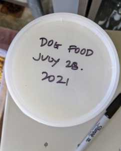 Each lid is marked with the contents and the date it was prepared.