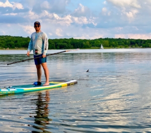Here is a closer look at Garrett on the paddle board. A stand up paddle board is much thicker than an average surfboard.