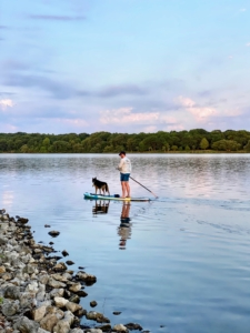 Paddle boarding is also a very good workout. Garrett is able to dip the blade fully into the water and take long strokes, using his strong back muscles to do the work.