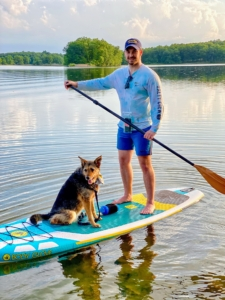 On this short paddle board ride, Garrett takes his Shepherd-Terrier mix, Bella. Because Garrett is already an experienced surfer, this was easy for him to do. Another tip - always hold the paddle with one hand on the top of the handle and the other on the shaft. Keep shoulders width apart, and toes pointed toward the nose. A coil ankle leash is also part of this board package. In fact, this board won a Connect Gear of the Year award in 2019.