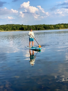 Garrett keeps his balance throughout. Beginners who are unaccustomed to paddle boarding and surfing should use a wider, longer board, which offers the greatest stability to learn the paddle board basics. As one gains experience, one can progress to smaller paddle boards.