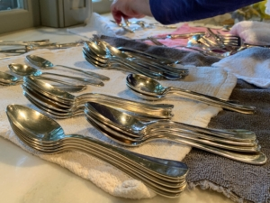 The finished pieces are dried and placed on another towel, so they can be sorted before being put away. Do not let silver air dry, because water left standing can cause spotting.