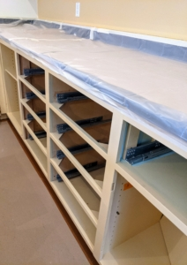 Next, all the drawers were removed and every surface not being painted had to be carefully covered.