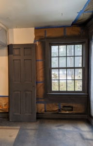 Doors and window trims are also primed and left to dry.