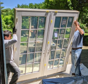 Beautiful French doors from Pella replace the timeworn ones.