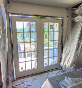 The doors are secured and ready to be fully attached and insulated. Whenever installing doors, be sure to always measure the radius of the swing and ensure there is adequate space for the door to open and close. Pella doors can be either in-swing our out-swing.
