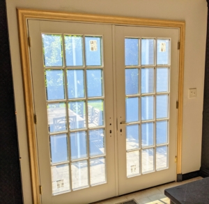 Here are the finished doors. Look how much great light comes into the kitchen. These doors will also allow fresh breezes in and out. This house has three sets of French doors - all of them were replaced in the same way.